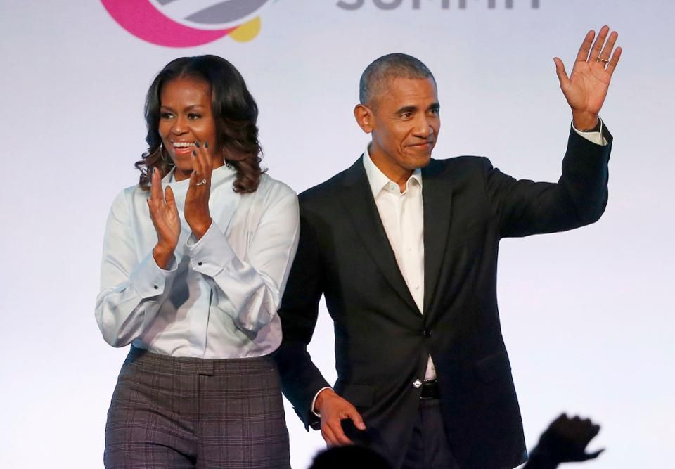 "Former President Barack Obama, right, and former first lady Michelle Obama appear at the Obama Foundation Summit in Chicago. The Obamas have unveiled a slate of projects in development for Netflix, a year after the former president and first lady signed a deal with the streaming platform. The Obamas' production company, Higher Ground Productions, announced Tuesday, April 30, 2019, a total of seven films and series that Barack Obama said will entertain but also ""educate, connect and inspire us all.""(AP Photo/Charles Rex Arbogast)"